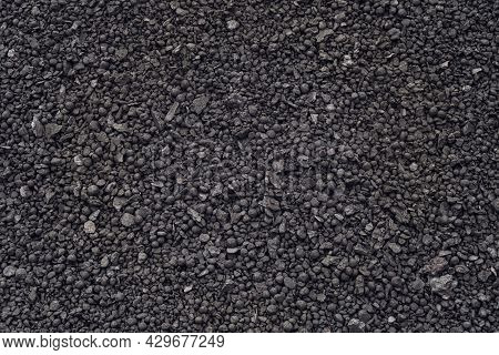 Iron Ore Pellets Close Up. Spherical Lumps Of Crushed Ore Concentrate. Semi-finished Product Of The