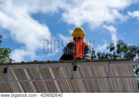The Roofer Technicians Work And Installing New Roof Structure On Top Roof Of House,metal Roof,fasten