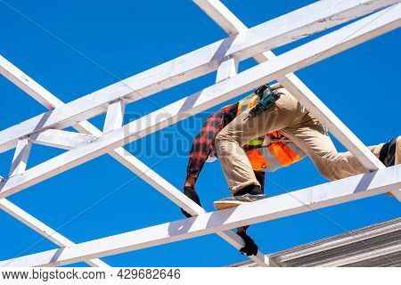 Roofer Worker In Protective Uniform Wear Installing Metal Roof On Top Of The New Roof,concept Of Res