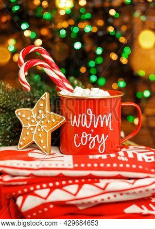 Hot Chocolate Infront Xmas Tree. Merry Christmas Greeting Card. Christmas Cappuccino In Red Mug On R