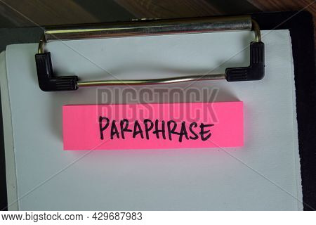 Paraphrase Write On Sticky Notes Isolated On Wooden Table.