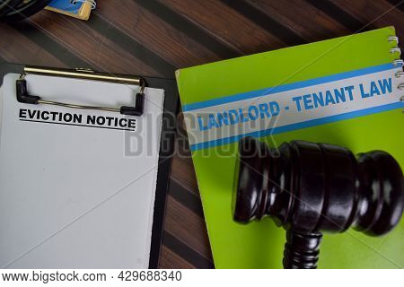 Eviction Notice Landlord - Tenant Law Write On A Paperwork Isolated On Wooden Table.