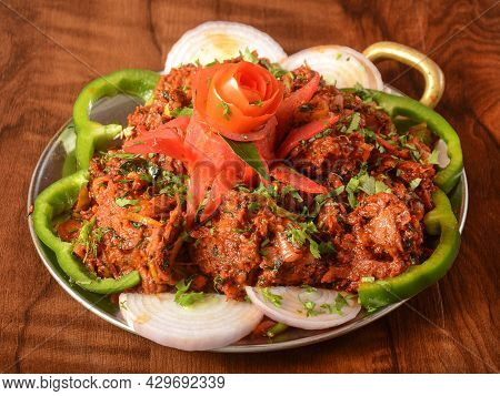Mutton Fry Or Lamb Fry, Spicy And Delicious Dish Served Over A Rustic Wooden Background, Selective F
