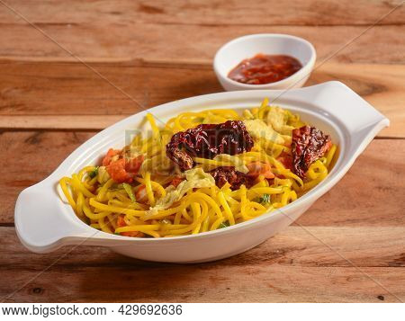Chicken Singapoori Noodles A Popular Indo Chinese Dish Made With Chicken, Noodles And Vegetables, Se