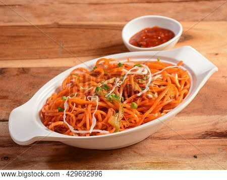 Schezwan Veg Noodles A Popular Indo-chinese Dish Made With Noodles, Vegetables And Schezwan Sauce, S