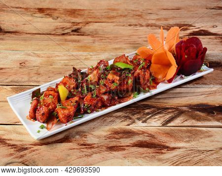 Paneer Chilli Is Indo Chinese Cuisine Dish, Paneer Cubes Tossed With Tomatoes, Onions, Spring Onions
