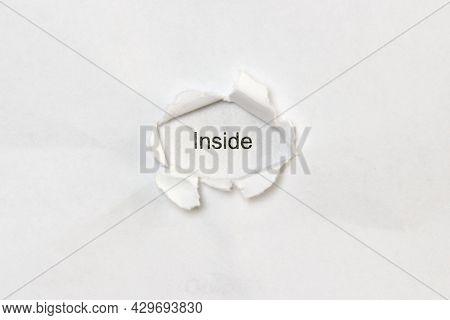 Word Inside On White Isolated Background, The Inscription Through The Wound Hole In Paper. Concept O