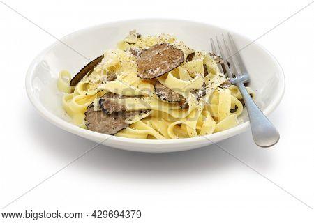 tagliatelle pasta with black truffle isolated on white background
