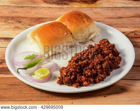 Mutton Kheema Pav Or Keema Pav Is A Spicy Curry Dish Made Up Of Minced Mutton Cooked With Onion, Tom