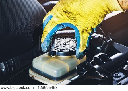 The Mechanic Hand Is Open Or Close The Cap Of The Power Steering Fluid To Check The Hydraulic Fluid