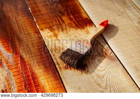 Brush For Covering Wood In A Jar On A Wooden Surface. Protecting Wood From Water, Varnishing Floors,
