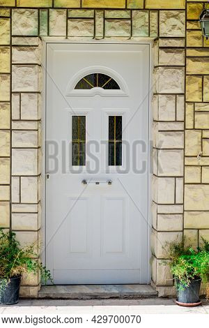 Entrance White Door With A House In A Laconic Style Close-up