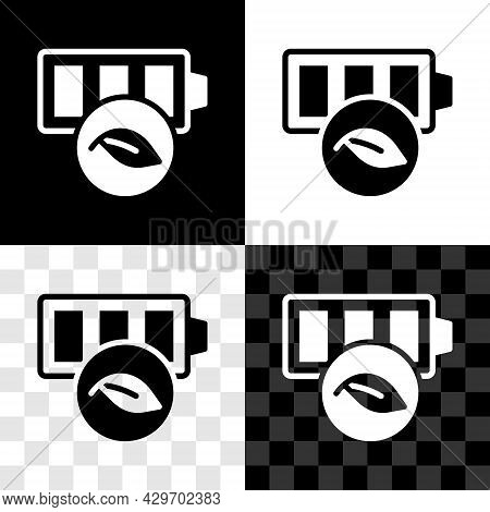 Set Eco Nature Leaf And Battery Icon Isolated On Black And White, Transparent Background. Energy Bas