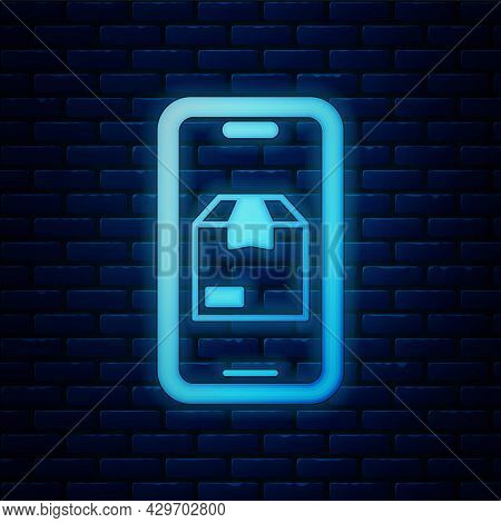Glowing Neon Mobile Smart Phone With App Delivery Tracking Icon Isolated On Brick Wall Background. P