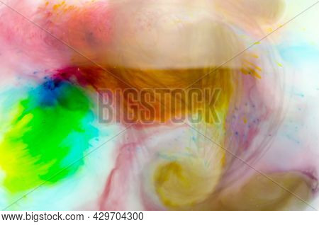 Spots, Streams And Dots Of Different Colors Of Watercolors In Transparent Water. Abstract Compositio