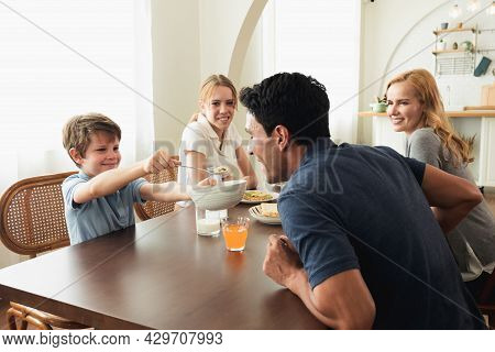 Happy Caucasian Family Talking To Each Other During Breakfast Together At Home. Father Mother Talk T