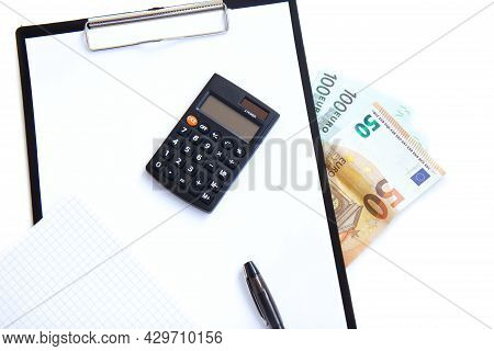 Calculator, Pen, Paper Money And Notebook Isolated On White Background. Concept Payment Of Taxes And