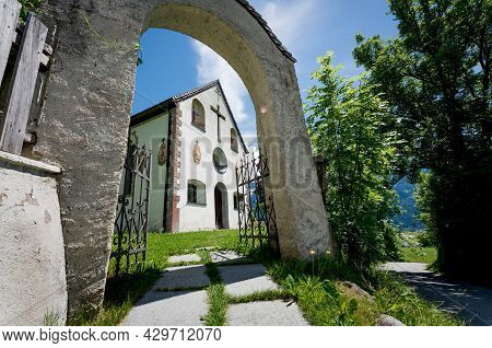 Sunny Entrance Gate To The Small Village Church Of The Alpine Mountain Area In Mieming, Tirol, Austr