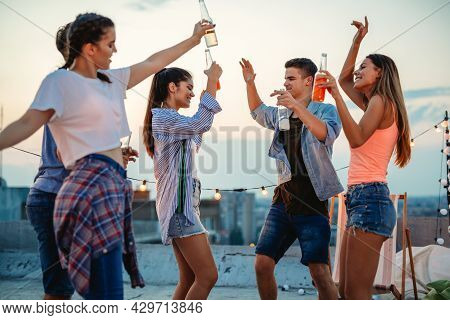 Group Of Happy Friends Having Fun At Rooftop Party.