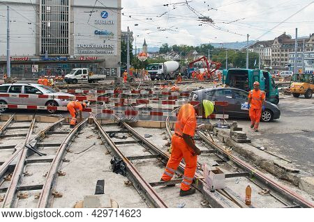 Zurich, Switzerland, July 10, 2017: Road Workers Repair The Street With A Tramline In The City Cente