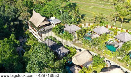 Aerial View Of Luxury Hotel With Villas And Pool In Tropical Jungle And Palm Trees. Luxurious Villa,