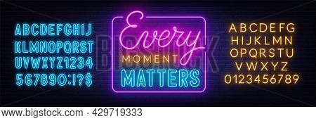 Every Moment Matters Neon Lettering On Brick Wall Background.