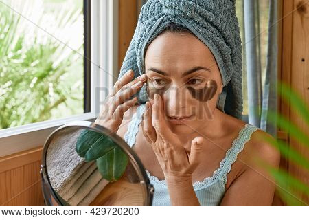 Skincare Routine. Middle Age Woman Touching Her Face With Wrinkles And Hydrogel Under-eye Patches, L