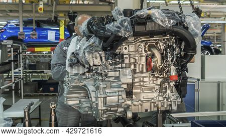 The Engine On Tray In The Car Factory. Newly Manufactured Engine On The Production Line In A Factory