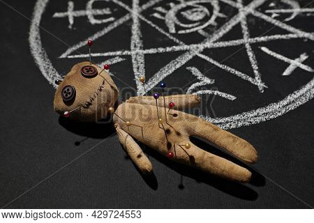 Voodoo Doll Near Ritual Circle Drawn On Black Table