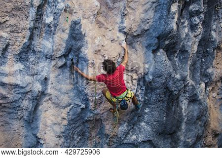 A Strong Man Climbs A Rock, Strong Back Muscles, Rock Climbing In Turkey, Training Endurance And Str
