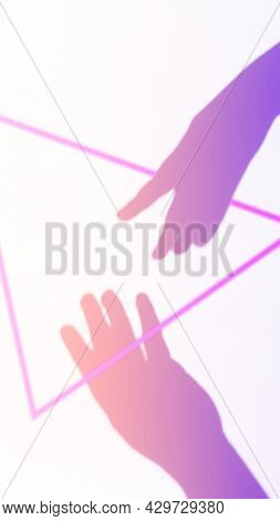 Two Female Hands Reach Out For Each Other. Neon Tinted With A Triangle. Helping Hand Silhouette, Fem