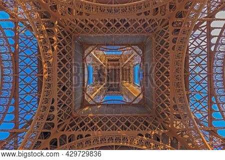 Vertical View Of Eiffel Tower In Paris From Ground Perspective