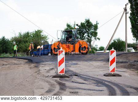 Kharkov, Ukraine - 17 July 2021. Shallow Dof Road Works Restraints. Unfocused Reflective Paint Sign.