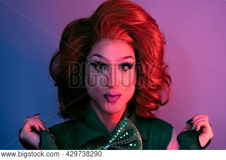 Portrait Of Drag Queen On Colored Background Looking Into The Camera