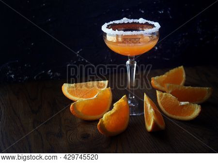 Refreshing Boozy Sidecar Cocktail With A Sugar Rim. Orange Cocktail At The Glass With Sugar