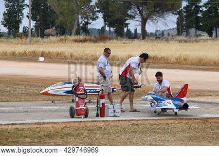 Apulia, Italy - June 3, 2017: Enthusiasts Of Alipuglia Rc Aircraft Club Take Part In A Local Radio C