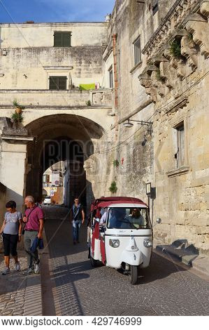 Matera, Italy - June 3, 2017: People Visit Sassi Districts In Matera, Italy. The Old Town Is Listed