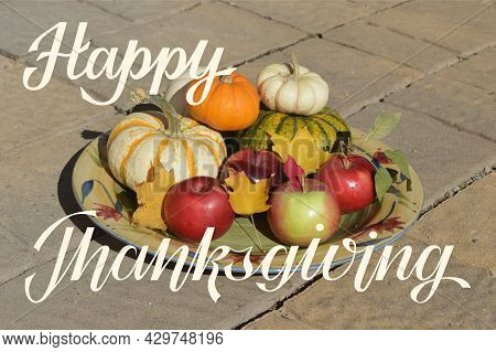 Happy Thanksgiving Hand Lettering With A Photo Background With Fall Harvest Apples, Pumpkins And Map
