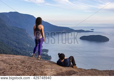 Adventure Photographer Taking Picture Of A Woman Hiker On Top Of A Mountain. Tunnel Bluffs Hike, Nor