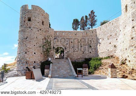 Kusadasi, Turkey - June 2, 2021: This Is The Main Gate To Ottoman Guvercinada Fortress (15th Century