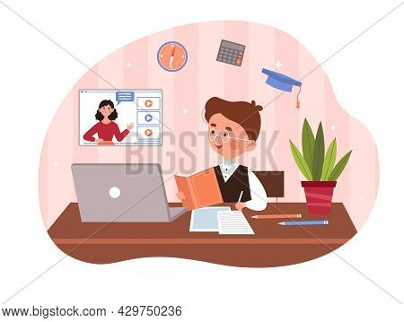 Cute Little Boy Is Sitting Behind His Desk Studying Online Using His Laptop. Concept Of Studenrs Stu