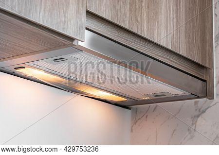 Close-up On Under Cabinet Range Hood, Exhaust Vent Hood In Kitchen.