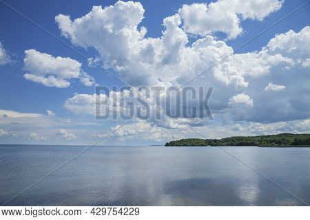 Mille Lacs Lake Southwest Side Below Dramatic Clouds In North Central Minnesota On A Sunny Summer Af