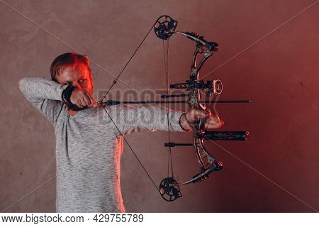 Archer Man With Modern Block Sport Bow And Arrow.