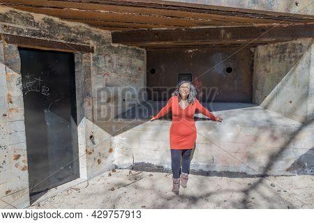 Walvisbunker In Burgh-haamstede, Zeeland, Netherlands. April 26, 2021. Senior Woman Standing Next To