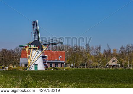 Green Grass Esplanade With De Leile Flour Mill Built In 1868, Mill With Valves And Wooden Fins, Whit