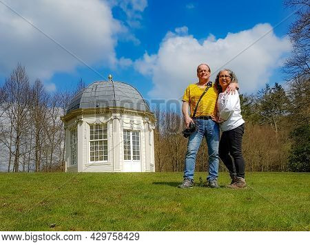 Mature Tourist Couple, A Mexican Woman And A Dutch Man With The Tea Dome Or Theekoepel Or Gloriette