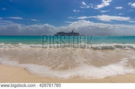 Half Moon Cay, Bahamas - February 19, 2020: Carnival Freedom Anchoring By Half Moon Cay Island. Gorg