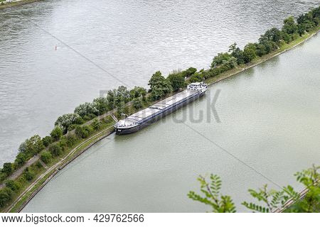 Barge With A Covered Deck Attached To The River Bank, Aerial View.