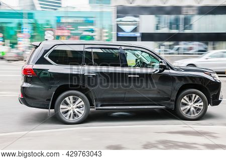 Black Luxury Lexus Lx570 Driving In City With Motion Blur. Fast Speed Motion On The City Road. Mosco